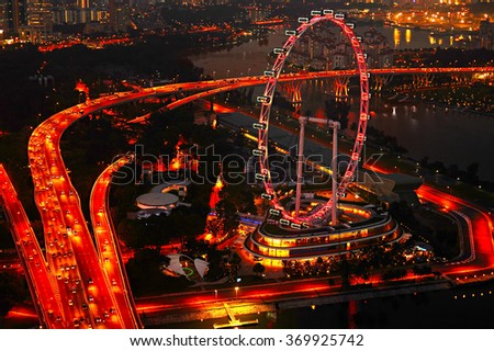 Aerial view on Singapore Flyer from Marina Bay Sands resort at night