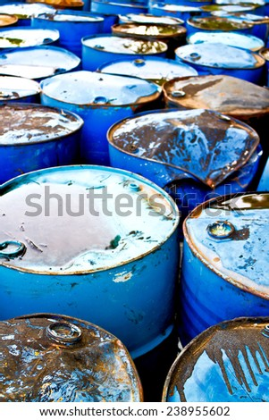 Aerial view on top of used blue oil drums - stock photo