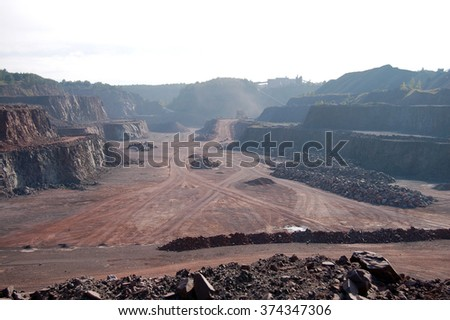 aerial view over a quarry hole. mining industry - stock photo