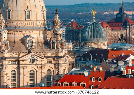 Aerial view over Frauenkirche and glass dome of Academy of Fine Arts or Lemon Squeezer and roofs of old Dresden, Saxony, Germany - stock photo