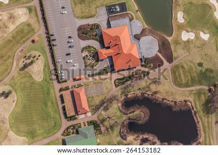 Aerial view over golf field in Poland - stock photo