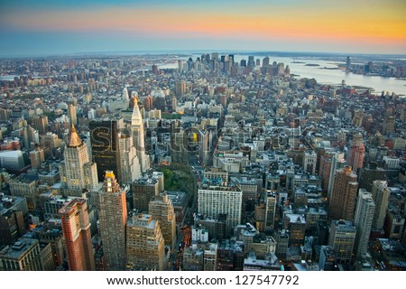 Aerial view over lower Manhattan, New York at sunset - stock photo