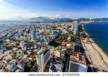 Aerial view over Nha Trang city, Vietnam taken from rooftop, extreme wide angle - stock photo