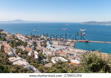 Aerial view over port, city and straits of Gibraltar with the African coast in the background