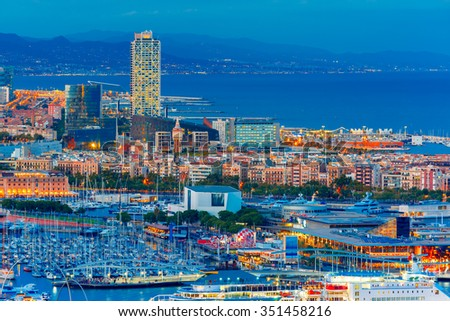Aerial view over Port Vell marina, Barceloneta and Rambla de Mar at night in Barcelona, Catalonia, Spain - stock photo