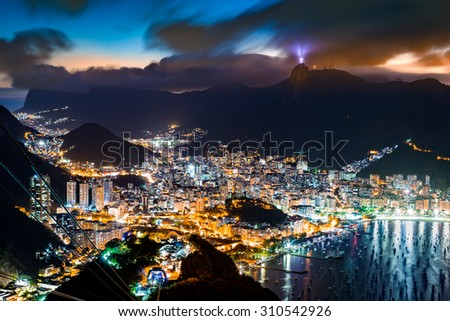 Aerial view over Rio de Janeiro on a hazy night, as viewed from Sugar Loaf peak. - stock photo