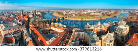 Aerial view over river Elbe with Augustus Bridge, Hofkirche, Royal Palace and roofs of old Dresden, Saxony, Germany - stock photo