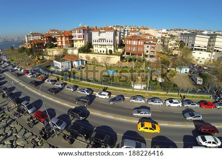 Aerial view over Salacak Sahil Yolu Street in Istanbul. Showing many cars and street as well as luxury housing along Bosphorus Sea. - stock photo