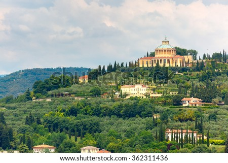 Aerial view over Shrine of Our Lady or Sanctuary of Madonna of Lourdes in cloudy summer day, Verona, Italy - stock photo