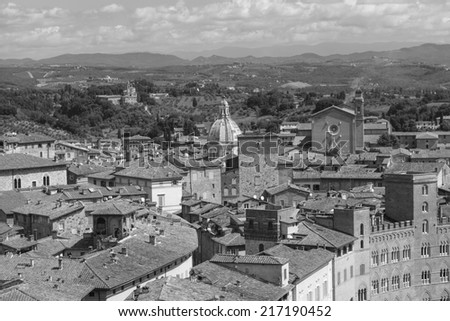 Aerial view over Sienna (city in Tuscany) in Italy, Europe (black and white) - stock photo