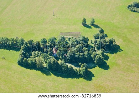 aerial view over small village - stock photo