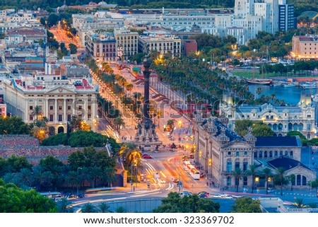 Aerial view over square Portal de la pau, and Port Vell marina and Columbus Monument at evening in Barcelona, Catalonia, Spain - stock photo