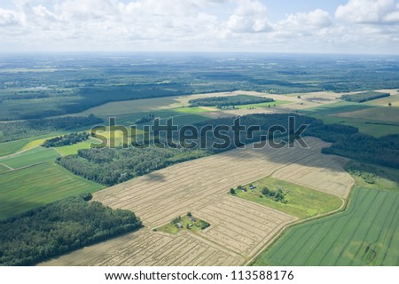 aerial view over the agriculrural fields - stock photo