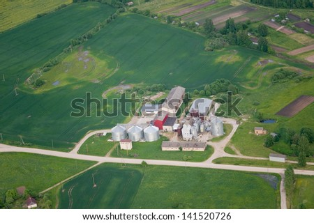 aerial view over the agricultural farm - stock photo
