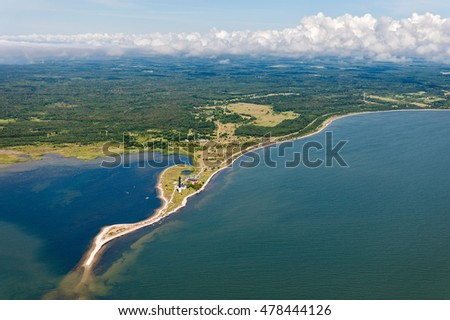 aerial view over the coast of Saaremaa island and Saµrve Lighthouse