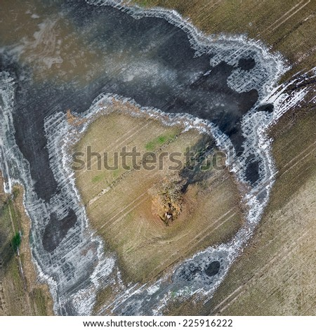 aerial view over the field in autumn - stock photo