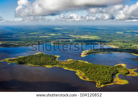 aerial view over the lake and island - stock photo