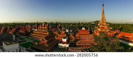 Aerial view over the  Mandalay Palace Area at early sunset - stock photo