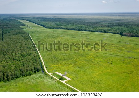 aerial view over the meadows - stock photo