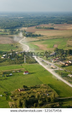 aerial view over the meadows and fields - stock photo