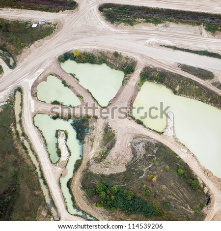 aerial view over the sandpit and ditches - stock photo