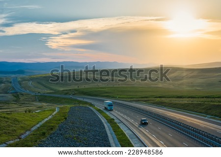 aerial view over the Transylvania highway at sunset - stock photo