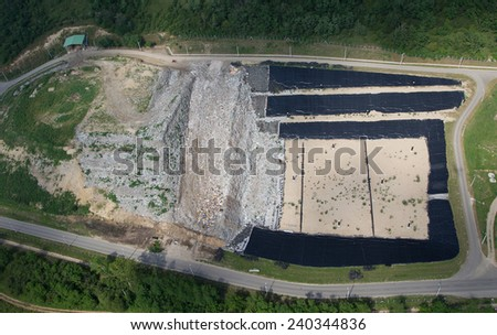 Aerial view over the waste dump - stock photo