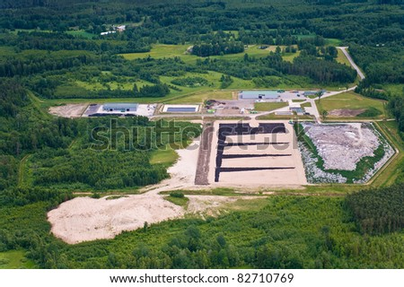 aerial view over the waste dump and recycling center - stock photo