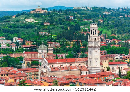 Aerial view over Verona Cathedral Duomo, Sanctuary of Madonna of Lourdes and church San Giorgio in Braida in cloudy summer day, Verona, Italy - stock photo