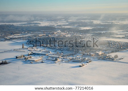 Aerial view over village in the winter