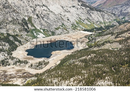 aerial view showing low water level in South Lake reservoir in California because of drought - stock photo