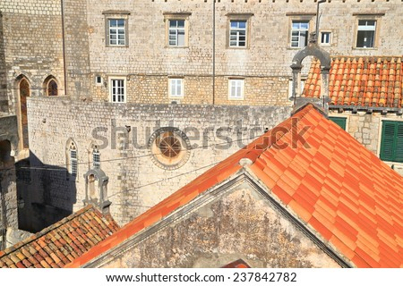 Aerial view to orange rooftop and old buildings in the old town of Dubrovnik, Croatia - stock photo