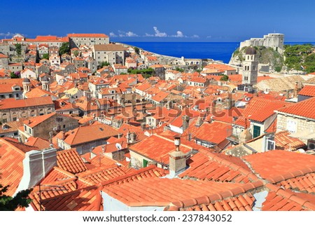 Aerial view to orange rooftops and old buildings in the old town of Dubrovnik, Croatia - stock photo