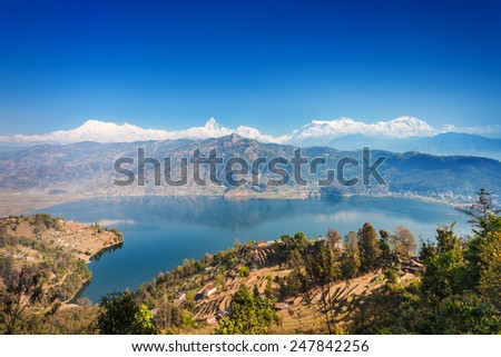 Aerial view to Phewa lake and Annapurna range from World Peace Pagoda in Pokhara, Nepal  - stock photo
