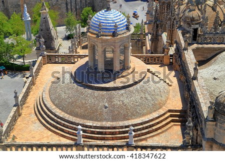 Aerial view to the dome above the Cathedral of Saint Mary of the See (Seville Cathedral) in Seville, Andalusia, Spain - stock photo