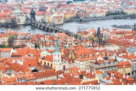 Aerial view to the historical center of Prague, Czech republic and famous Charles bridge (Karlov most) over Vltava river - UNESCO world heritage site - stock photo