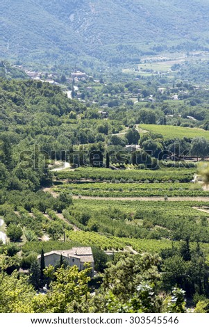 aerial view, typical landscape in South Europe with an old winery, vineyards, fields, meadows and mountains, Provence, France, vertical - stock photo