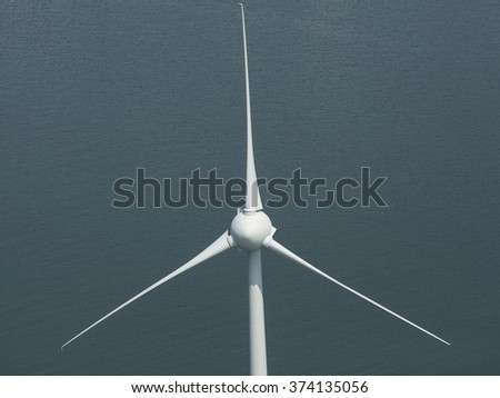 Aerial view, zoomed on the rotor blade of a wind turbine at the coastline of the IJsselmeer , The Netherlands.  - stock photo