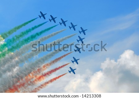 aerobatics team flying in formation with colored smoke