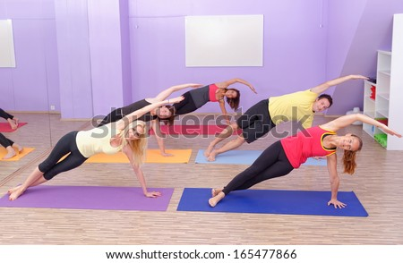 Aerobics Hot pilates class with yoga balls in a row on fitness class - stock photo