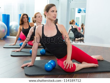 Aerobics pilates women with toning balls in a row on fitness class