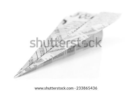 Aeroplane origami from newspaper isolated on white background - stock photo