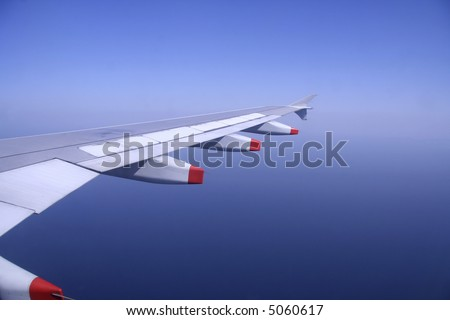 aeroplane wing flying in the sky
