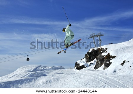 Aeroski: a skier executing a tele-heli with his skis crossed during a jump