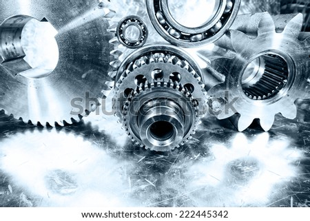 aerospace cogwheels, gears and ball-bearings, mirrored in brushed aluminum - stock photo