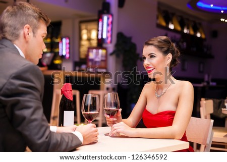 affectionate couple enjoying in a romantic restaurant - stock photo