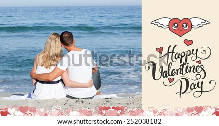 Affectionate couple sitting on the sand at the beach against happy valentines day - stock photo