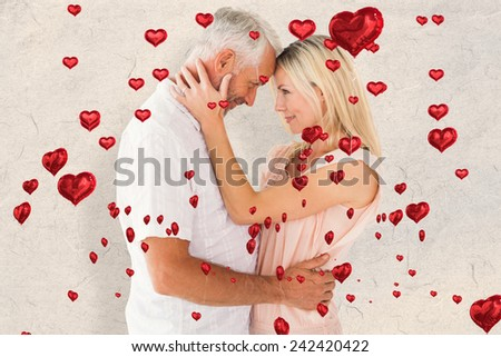 Affectionate couple standing and hugging against parchment - stock photo
