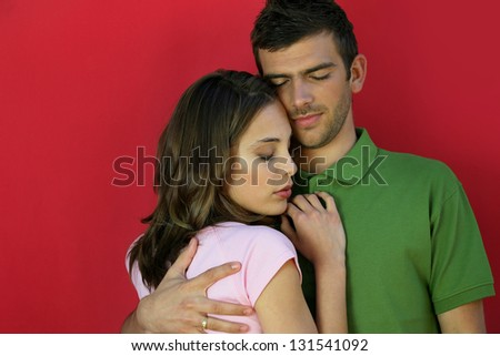 Affectionate couple stood close together - stock photo