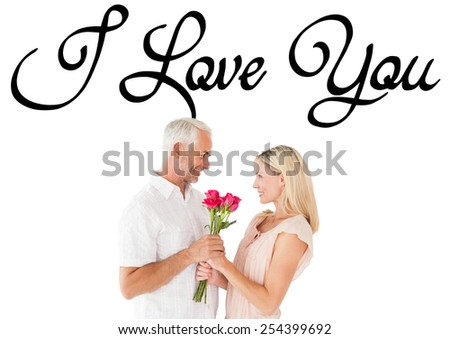 Affectionate man offering his partner roses against i love you - stock photo